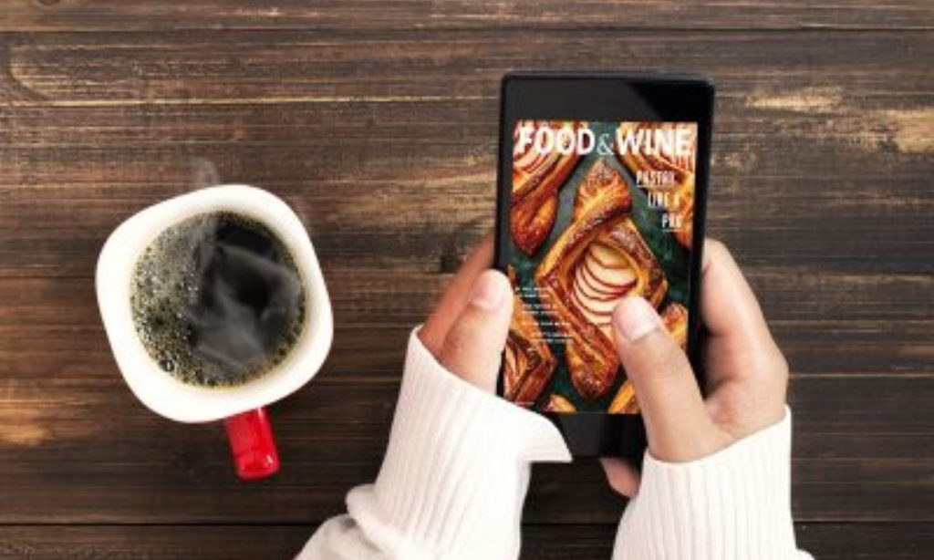 eMags Rewards digital magazine displayed on an iPhone with warm coffee and girl in cozy sweater