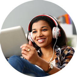 woman listening to magazine content on her tablet using headphones